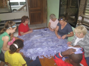 Children help out with making blankets.