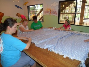 Sharon, Linda, Christy and Ayla making tie blankets.
