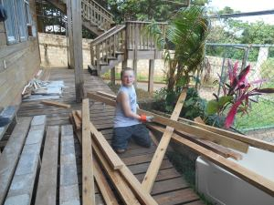 Nate sorting through wood for the bunk bed ministry.