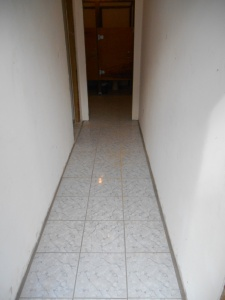 Hallway leading to the school bathroom that the team tiled.