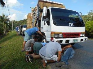 Team fixing a flat.
