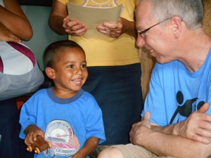 Rick sharing his time and a toy with a young boy from Oak Ridge