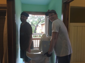 Wade and John removing an old toilet
