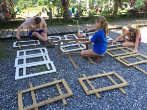 Anna, Naomi, and Jon priming frames for the bulletin boards.